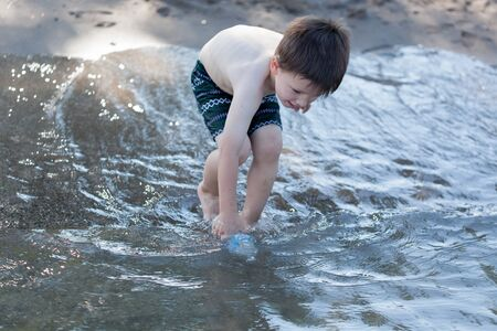 ankle deep in water: Child, Innocence, Bottle, People, 4-5 Years, One Boy Only, Children Only, Childhood, Bending, Drinking Water, Water Bottle, Males, Boys, Shirtless, Shorts, Holding, Filling, Motion, Standing, Horizontal, Lifestyles, Leisure Activity, Summer, Only Boys, Fo