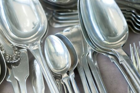 consumerism: Abundance, Antique, Choice, Close-up, Colour Image, Consumerism, Cutlery, Differential Focus, Eating Utensil, Flea Market, For Sale, Fork, Horizontal, Kitchenware Shop, Large Group Of Objects, Man Made Object, Metal, Metallic, No People, Old, Old-fashione Stock Photo