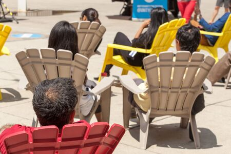 colour image: Chair, Colour Image, Day, Horizontal, Human Head, Medium Group Of People, Outdoors, Photography, Rear View, Relaxation, Shadow, Sitting, Sunlight, Sunny, Leisure Activity, Lifestyles