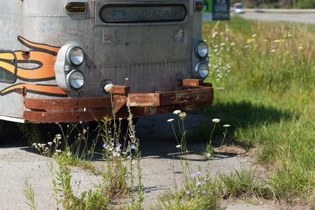 colour image: Land Vehicle, Abandoned, The Past, Damaged, Obsolete, Run Down, Van, Weathered, Rusty, Stationary, Gray, Colour Image, Horizontal, Lighting Equipment, Metal, Mode Of Transport, Old, Old-fashioned, Photography, Transportation, Vintage, Outdoors, Day, No Pe Stock Photo