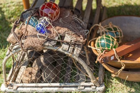 commercial fishing net: Fishing Industry, Close-up, Colour Image, Commercial Fishing Net, Crab Pot, Horizontal, Still Life, No People, Photography, Lobster Pot, Netting, Safety, Buoy, Safety Equipment, Protection, Equipment, Medium Group Of Objects, Outdoors, Day, Differential F