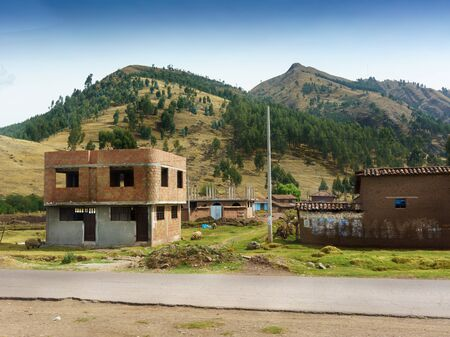 reside: Architecture, Building Exterior, Built Structure, Colour Image, Construction, Cusco City, Day, Horizontal, House, Incomplete, Landscape, Mountain, Mountain Range, No People, Outdoors, Peru, Peruvian Culture, Photography, Pole, Residential Building, Reside
