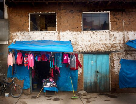 consumerism: Architecture, Bicycle, Building Exterior, Built Structure, Choice, Clothing, Colour Image, Consumerism, Cusco City, Cycle, Day, Door, Hanging, Horizontal, Large Group Of Objects, Market, Merchandise, No People, Outdoors, Peru, Peruvian Culture, Photograph Stock Photo