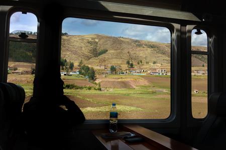 Adults Only, Bottle, Colour Image, Cusco City, Day, Hill, Horizontal, House, Journey, Landscape, Looking Through Window, Men, Mode Of Transport, Mountain, Mountain Range, Nature, One Person, Only Men, Outdoors, Passenger, Passenger Train, Peru, Peruvian C 免版税图像