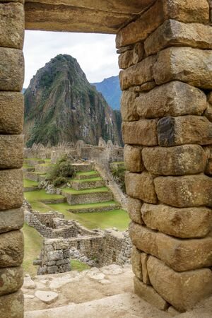 cusco province: Mt Huayna Picchu, Cusco Region, Urubamba Province, Inca, Peru, Aguas Calientes - Machupicchu District, Vertical, Colour Image, Pre-Columbian, UNESCO World Heritage Site, Stone - Material, Circa 15th Century, Ancient Civilisation, Machu Picchu Incan Ruins, Stock Photo