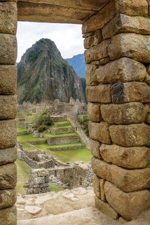 Mt Huayna Picchu, Cusco Region, Urubamba Province, Inca, Peru, Aguas Calientes - Machupicchu District, Vertical, Colour Image, Pre-Columbian, UNESCO World Heritage Site, Stone - Material, Circa 15th Century, Ancient Civilisation, Machu Picchu Incan Ruins, Stock Photo