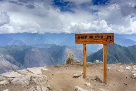 Mountain Range, Mountain, Travel Destinations, Colour Image, Day, Directional Sign, History, International Landmark, Machu Picchu, Nature, No People, Scenics, Travel, Horizontal, Road Sign, Guidance, Western Script, Text, Roadside, Information Sign, Touri