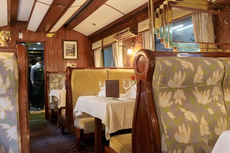 Colour Image, Photography, Indoors, Incidental People, Horizontal, Dining Table, Elegance, Luxury, Food And Drink, Absence, Empty, Preparation, Silver Service, Tablecloth, Seat, Train - Vehicle, First Class, Restaurant, Compartment, Vehicle Interior, Wind