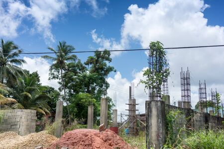 construction plant: Cloud - Sky, Colour Image, Construction, Construction Frame, Construction Industry, Construction Site, Day, Development, Growth, Horizontal, Incomplete, No People, Outdoors, Palm Tree, Photography, Plant, Power Cable, Sky, Tree, Trinidad - Trinidad And To Stock Photo