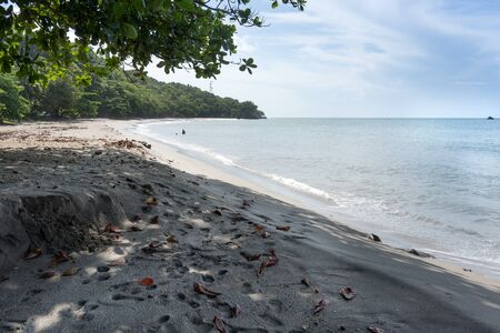 colour image: Beach, Coastal Feature, Coastline, Colour Image, Day, Horizontal, Island, Nature, No People, Non-urban Scene, Outdoors, Photography, Sand, Scenics, Sea, Sky, Summer, Tourism, Tranquil Scene, Tranquillity, Travel, Travel Destinations, Tree, Trinidad And To Stock Photo