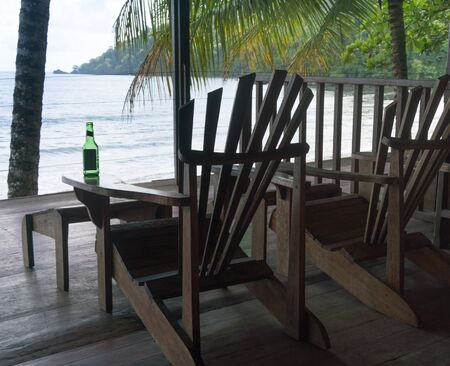 tropical climate: Colour Image, Horizontal, Photography, Day, Indoors, No People, Trinidad - Trinidad And Tobago, Trinidad And Tobago, Tourist Resort, Beach Holiday, Adirondack Chair, Empty, Absence, Wood - Material, Palm Tree, Tropical Climate, Vacations, Travel, Travel D