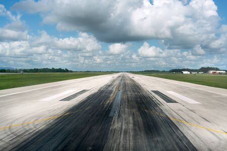 Colour Image, Horizontal, Photography, Day, Outdoors, No People, Sky, Cloud - Sky, Sunlight, Airport, Runway, Transportation, Travel, Public Transportation, Tarmac, Road, Road Marking, The Way Forward, Surface Level, Diminishing Perspective, Landscape, Tr Stock Photo