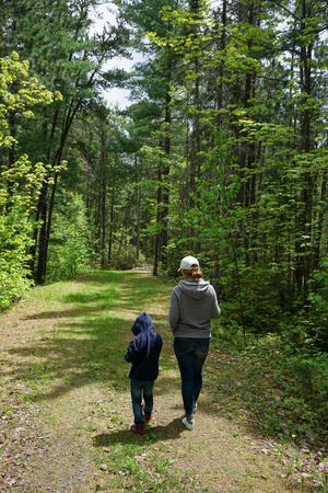 mother and child walking in the forest