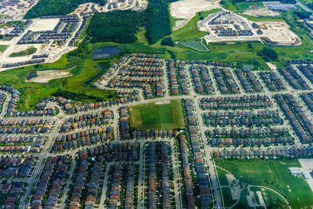 suburbia: Aerial view of houses in residential suburbs at day, Toronto, Ontario, Canada. aerial picture from ontario canada 2016 Stock Photo