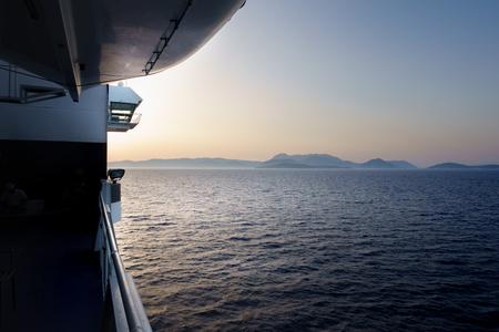 Ship sailing on sea during sunset Standard-Bild - 114958776