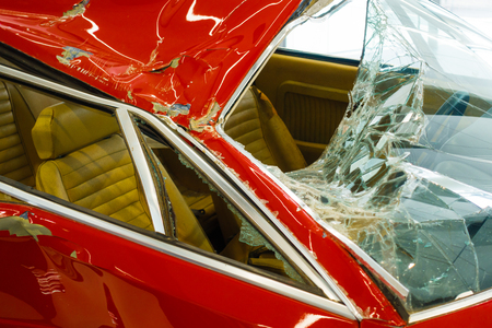 Damaged car with shattered windshield Stock Photo