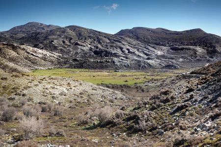 View of green field amidst mountain peak Crete Greece Europe