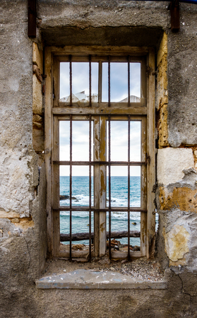 View of sea from window of old building Crete Greece Europe Stockfoto