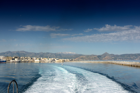 View of cruise ship trails in water Crete Greece Europe