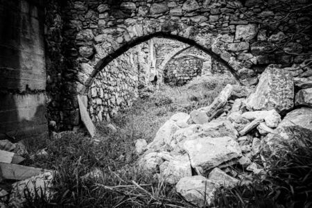 View of ancient weathered stone structure Фото со стока