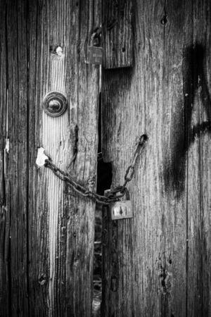 Chain lock on a weathered wooden door