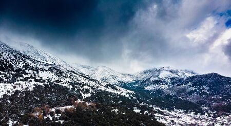 Snowcapped mountain landscape against cloudy sky, Crete, Greece