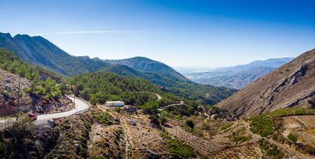 Scenic view of winding road and mountain against sky, Crete, Greece