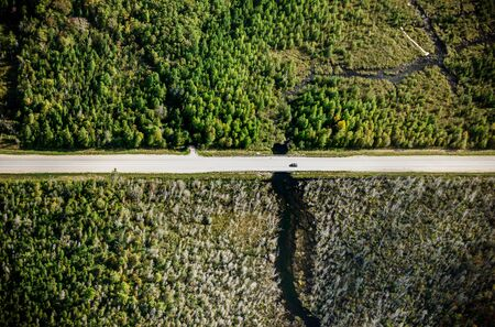 Aerial view of road amidst green agricultural field, Canada Reklamní fotografie