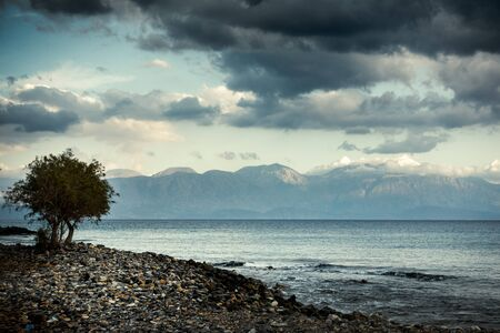 Seascape and mountain against cloudy sky, Crete, Greece