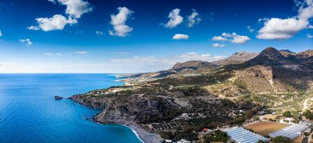 Scenic view of sea with agricultural field on mountain, Crete, Greece
