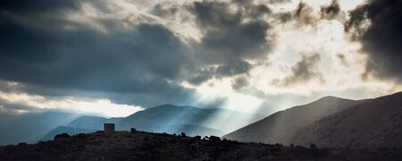 Silhouette of mountain landscape against cloudy sky, Crete, Greece