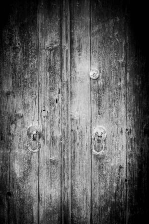 Full frame view of wooden door with metal door knob