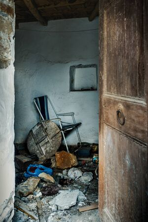 Broken furniture trash pile in abandoned home, Crete, Greece Reklamní fotografie