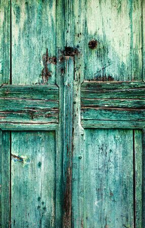 Full frame view of old blue colored wooden door