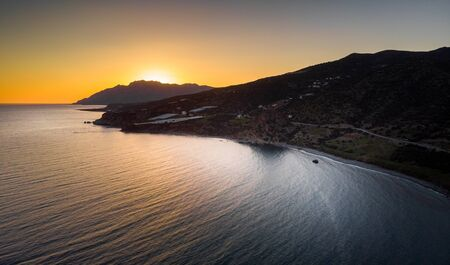 Scenic view of sunset by mountains and sea Reklamní fotografie
