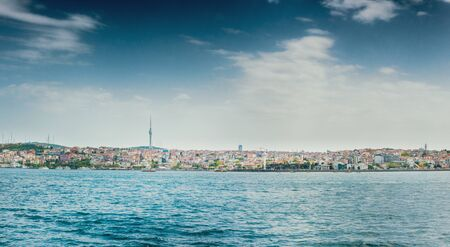 Sea and cityscape against cloudy sky, Istanbul