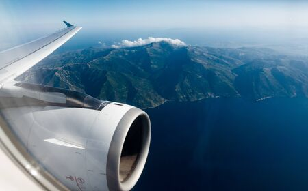 View of Crete island mountain and sea from airplane window,