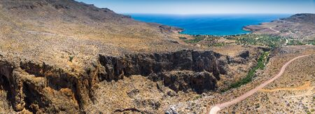 Panoramic of winding roads in the mountain and cliff by the sea, Greece