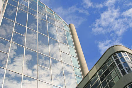 Low angle shot of sky reflected in modern buildings  photo