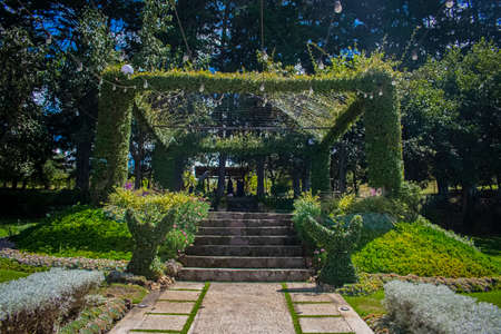 beautiful garden greens with galley decorated by flowers and openwork large back