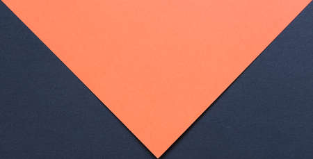 orange and black cardboard background, with the black part forming two triangles on the bottom