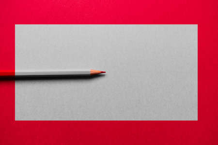 Red pencil over a red background, with a gray rectangle in the middle. The pencil is desaturated in the rectangle, except for its tip