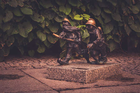 A picture of gnomes sculpted as firemen as seen in Wroclaw. Stock Photo