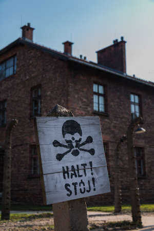 A picture of a warning sign in Auschwitz I. Stock Photo