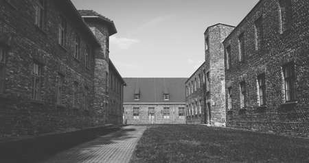 A black and white picture of the administrative buildings that make Auschwitz I.
