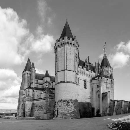 A black and white picture of the Ch�teau de Saumur taken from near its entrance.