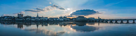 A panorama of Saumur focused on the river Loire and its landmarks.