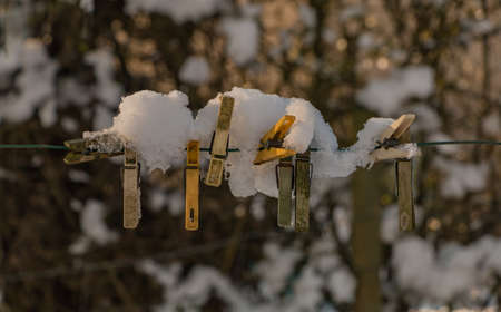 A picture of a group of snowy cloth clamps. Stock Photo