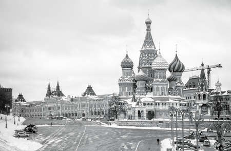 A black and white picture of Saint Basils Cathedral, the Red Square and the GUM shopping center. Stock Photo