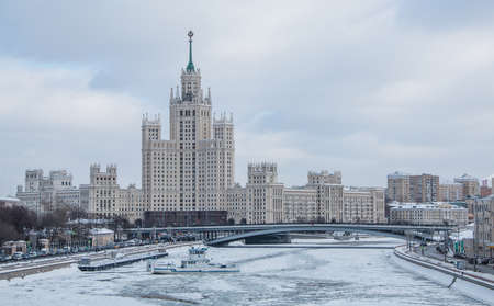 A picture of the Kotelnicheskaya Embankment Building and the frozen river. Editorial